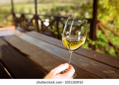 Swirling a wine glass in wine tastings