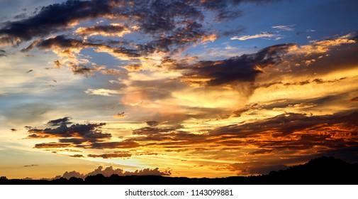 Swirly clouds a brilliant sunset sky
