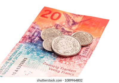 Swiss 20 franc banknote and coins isolated on white