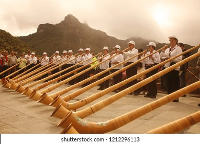 Swiss Alphorn player in the  mountain Village of Tejeda in the centre of the Canary Island of Spain in the Atlantic ocean.   Grand Canary, Tejeda, February, 2006