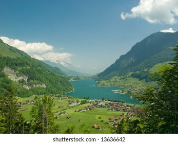 Swiss Alpine village and lake, Lunderer See, Switzerland