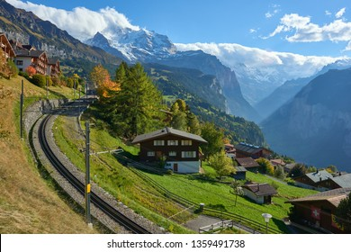 Swiss Alpine village Wengen with view to Lauterbrunnen valley and mountain railroad.