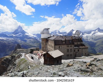Swiss Alps landscapes with Matterhorn mount in Switzerland, Kulm Hotel and observatory at 3,120 meters above sea level at Gornergrat with cloudy blue sky in 2017 cold sunny summer day, Europe on July.