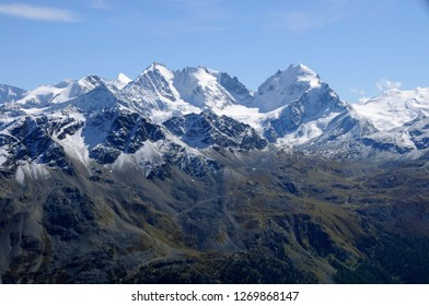 Swiss alps: Panoramic view from Piz Nair to Julier mountains in the upper Engadin. But due to the global climate change the glaciers and the permafrost are melting
