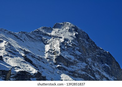 swiss alps  Peak covered with snow and ice