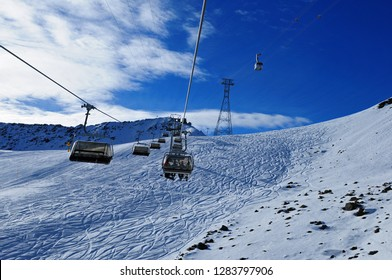 Swiss alps: Skiing on artificial snow due to the global climate change at Parsenn above Davos City where the WEF takes place