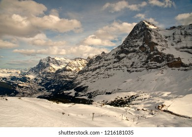 Swiss Alps. View  to the Grindelwald valley and north wall of Eiger peak. On the foreground ski-tracks of Grindelwald ski-resort.