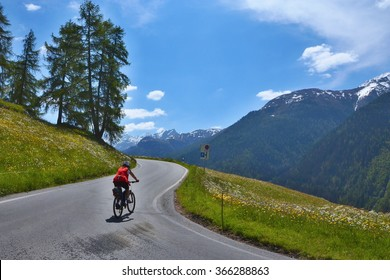 Swiss Alps,Resgia-view of the cyclist on the road