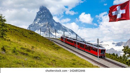 Swiss beauty, flag and rack railway under breathtaking Matterhorn,Zermatt,Valais,Switzerland,Europe
