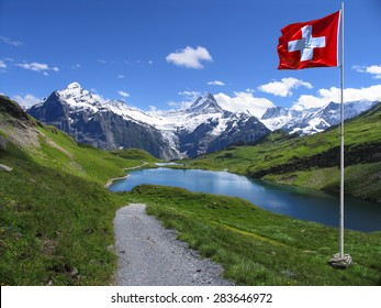 Swiss beauty, pathway to Bachalpsee under Schreckhorn and Wetterhorn mount