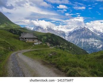 Swiss beauty, shack with Schreckhorn and Wetterhorn in clouds behind