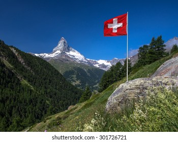 Swiss beauty, valley with flag under breathtaking Matterhorn
