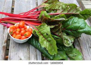 Swiss chard and cherry tomatoes in a white bowl