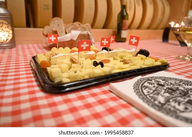 swiss cheese plate with swiss flags as a starter - Shutterstock ID 1995458837