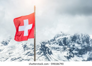 Swiss flag in the Alps of engadine valley