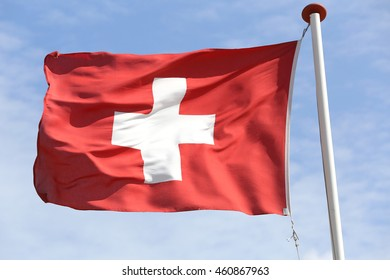 Swiss flag blowing in the wind