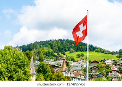 swiss flag with blue sky and city