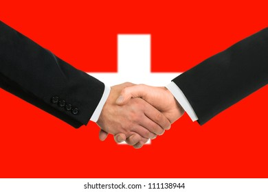 The Swiss flag and business handshake