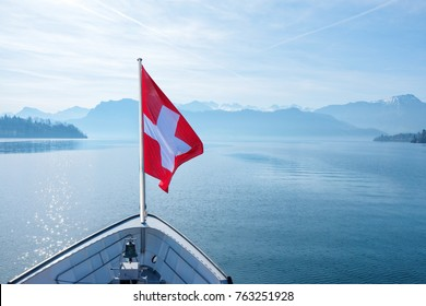 Swiss flag flying on boat and Rigi mountain view background