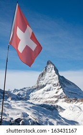 The Swiss flag infront of the Matterhorn