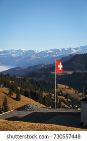 Swiss flag with mountain background