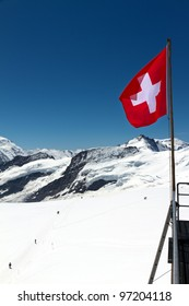 Swiss flag mountain snow on top of the Jungfraujoch