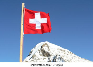 the swiss flag on a background of beautiful mountain peaks