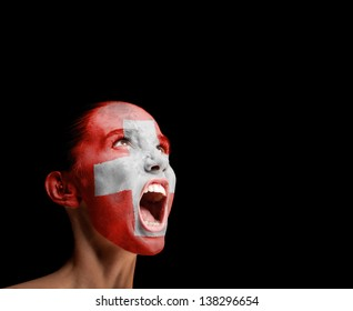 The Swiss flag on the face of a screaming woman. concept