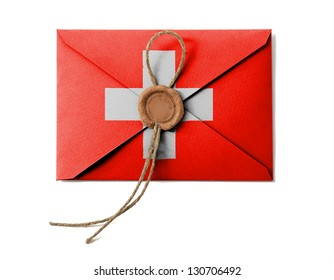 The Swiss flag on the mail envelope. Isolated on white.