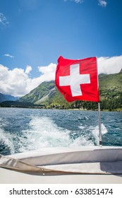 swiss flag on a ship at the lake sils