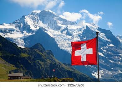 Swiss flag on the top of Mannlichen (Jungfrau region, Bern, Switzerland)
