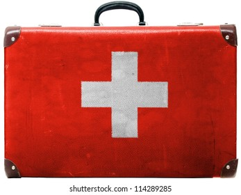 The Swiss flag painted on  old grungy travel suitcase or trunk
