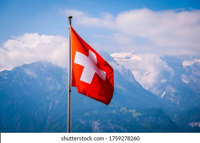 Swiss flag waving  with Mountains background