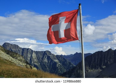 Swiss flag waving in the wind in Ticino, Switzerland.