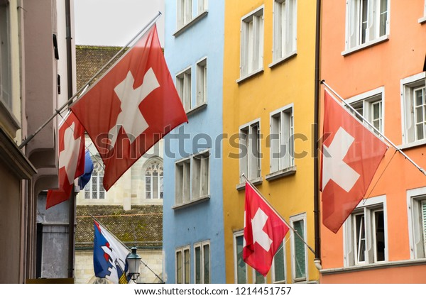 Swiss flags among colorful houses in the center of Zurich, Switzerland