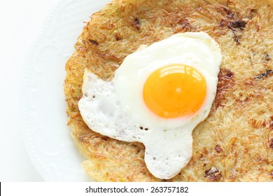Swiss food, sunny side up fried egg on Rosti