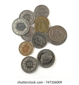 Swiss Francs coins on a white paper sheet
