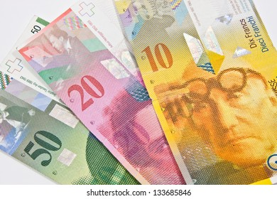 Swiss francs on a white background