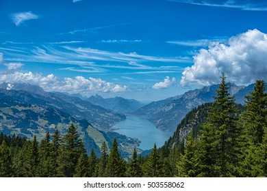 A Swiss lake surrounded by mountains