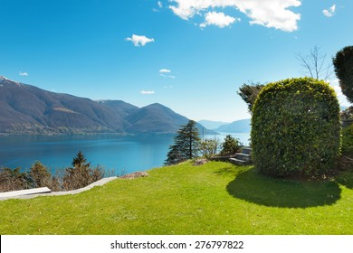 Swiss landscape: garden, mountains and lake