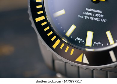 Swiss made diver watch on blurry background. Professional. Closeup of watch dial and bezel.  Copy space. Concept.