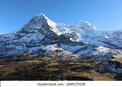 Swiss mountain with gras und snow
