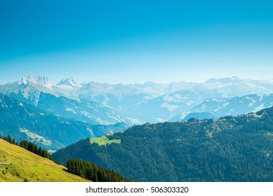 A Swiss mountain landscape with a blue sky