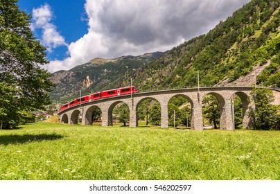 Swiss mountain train Bernina Express on the viaduct, Switzerland