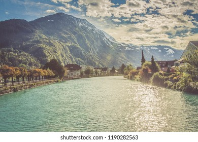 Swiss mountains, lake, sky landscape