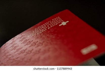 swiss passport close up on black background isolated switzerland citizenship