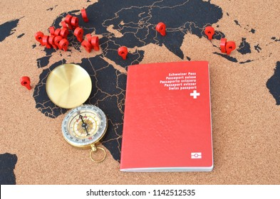 Swiss passport and compas on the pinboard ma