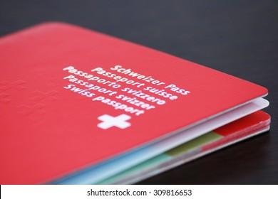 Swiss passport isolated on a dark wood background