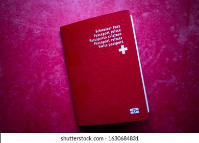 swiss passport on red background