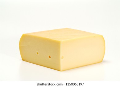 Swiss Raclette cheese block isolated on White background